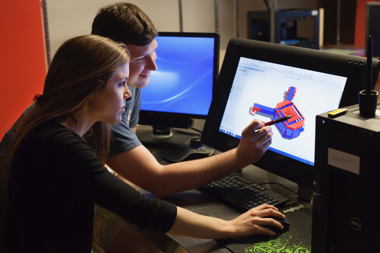 Two students designing a project