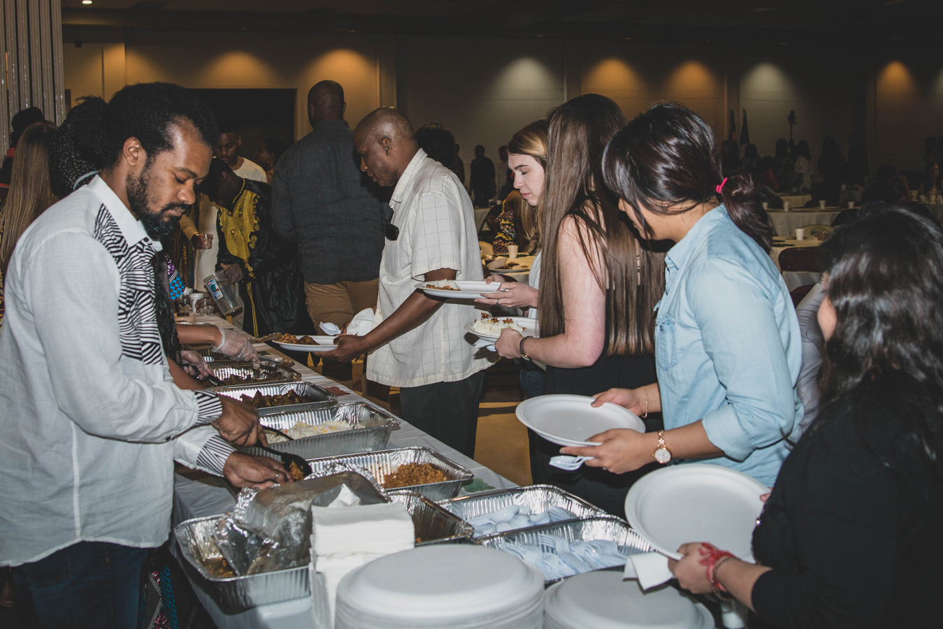 People lined up a buffet at African MegaFest