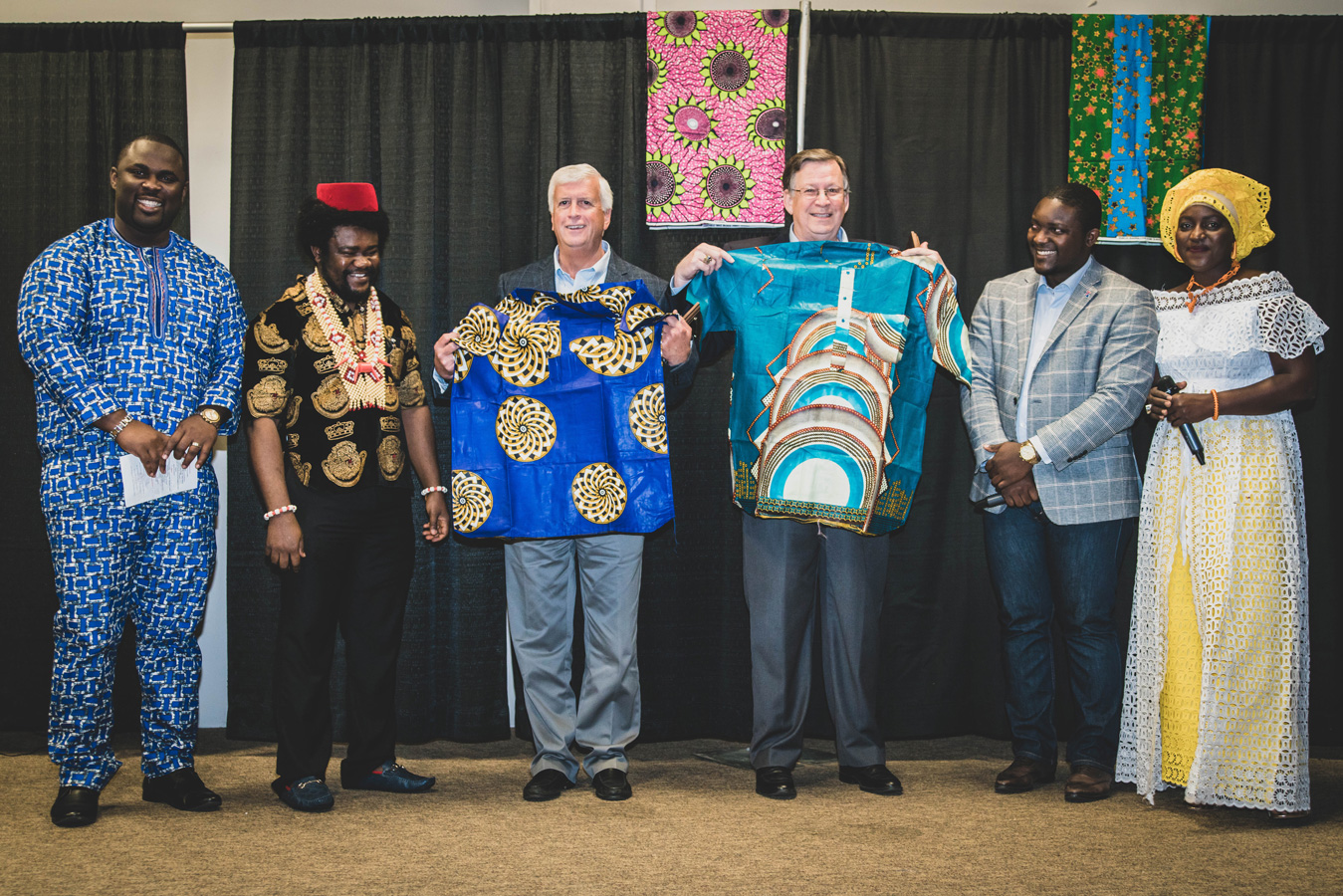 Ruston Mayor Ronny Walker and Tech President Dr. Les Guice with African MegaFest shirts on stage