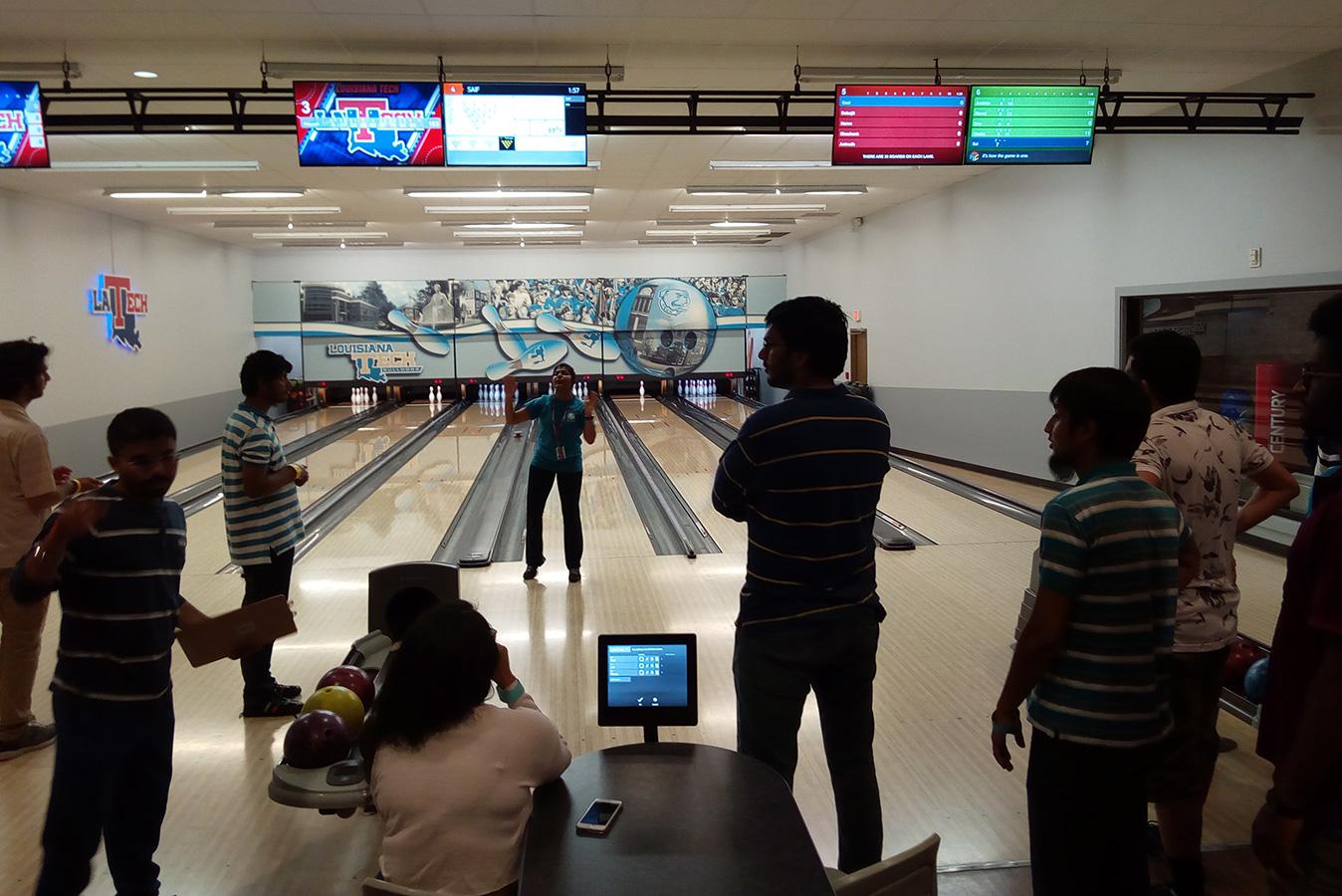 Graduate social at a bowling alley