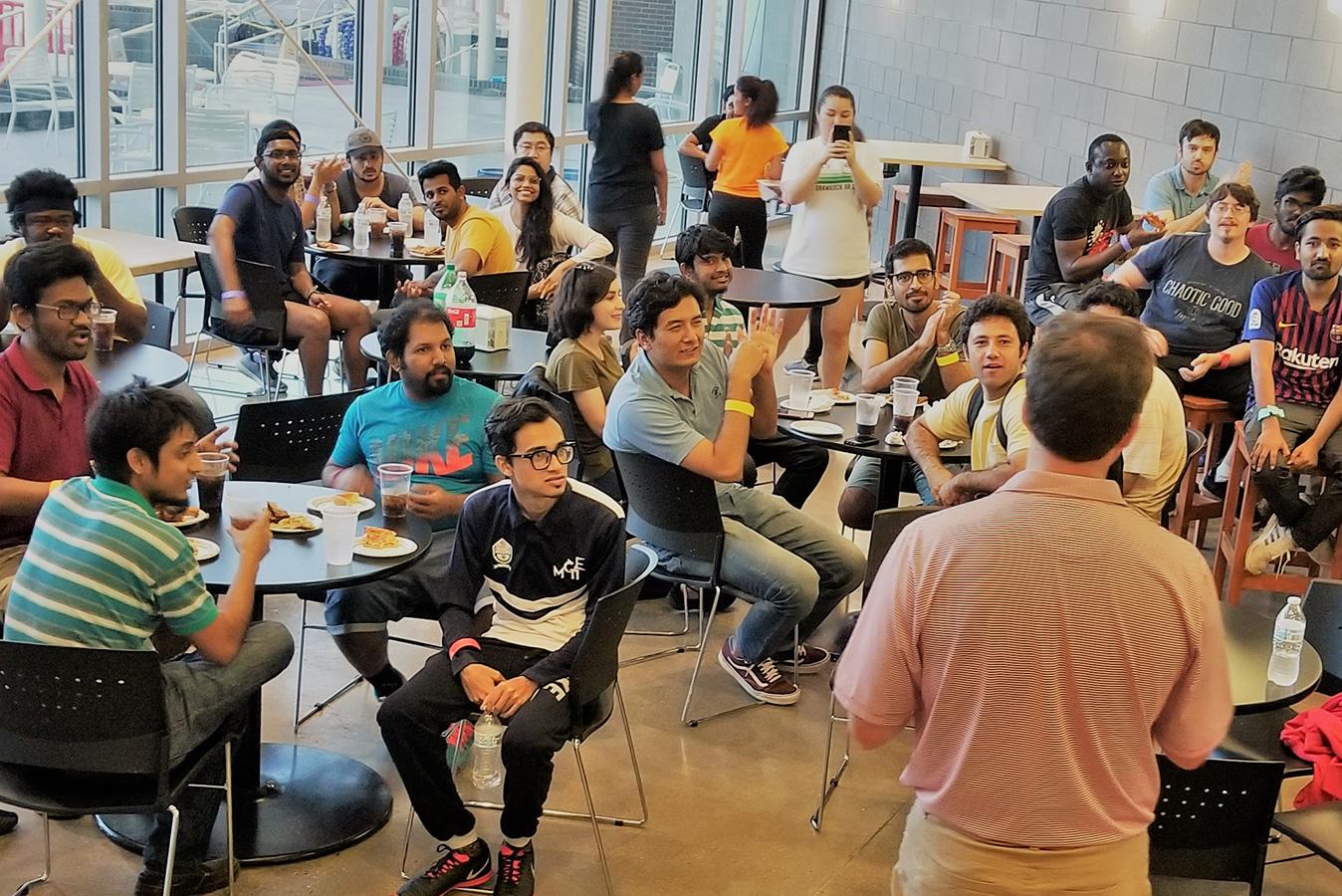 Students visiting at the 2019 graduate social